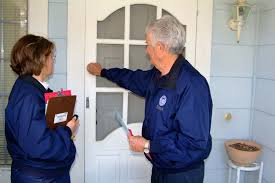 Couple in blue uniform knocking on the door